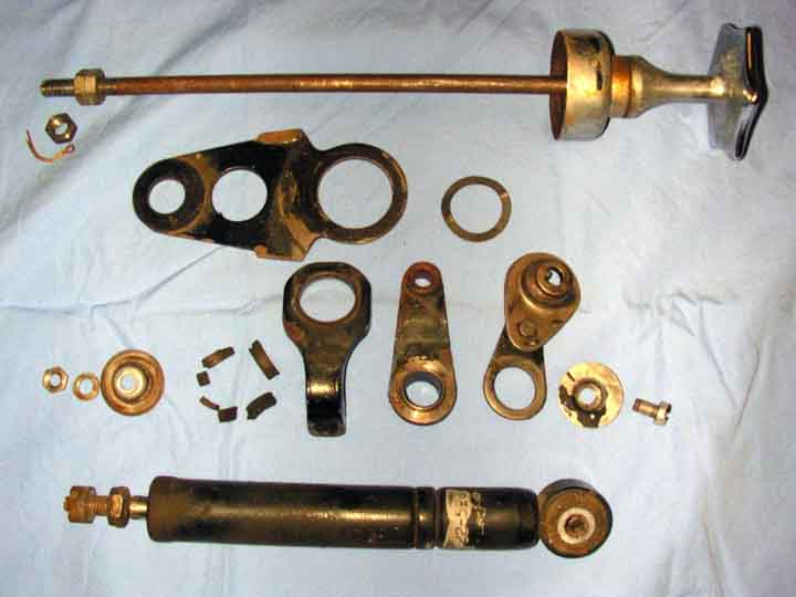 This shows the disassembled parts of the BMW motorcycle hydraulic steering damper for the R69S.